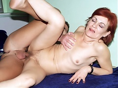 Pretty mature redhead Steph  sucking off our cock then goes on all fours for a pounding