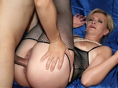 Explicit videos of a hot older woman named Lina sharing a cock with younger woman