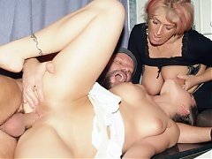 XXX videos of a busty mature named Christina sharing her husband with a younger woman