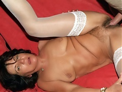 Slutty mature babe Agnes straddles our stunt cock on the couch then gets flipped over