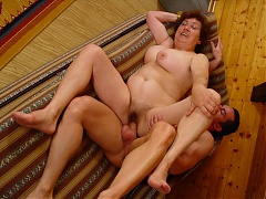 Valda is the experienced mature plumper riding a younger guys cock during a webcam session