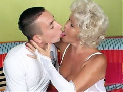 Big boobed elderly woman Francesca lures a younger guy into banging her pussy during a cam show