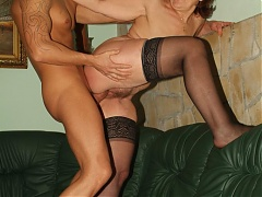 Paula shows us her big boobs and saggy ass while fucking a younger guy during a live show